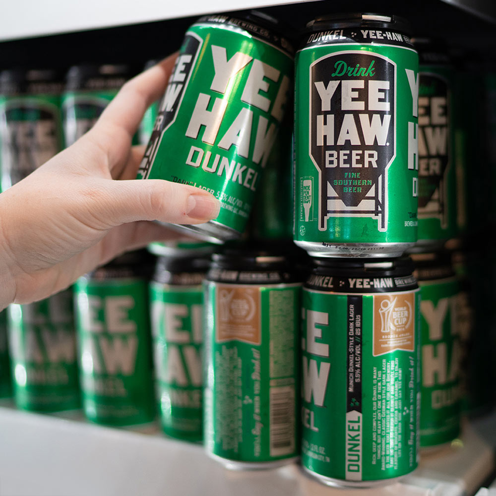 Cans of Yee-Haw Beer Dunkel
